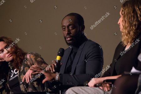 Ivanno Jeremiah talks during a Q&A following a screening for 'The Flood' in London
