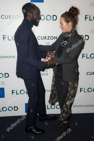 Lena Headey, Ivanno Jeremiah. Actors Lena Headey and Ivanno Jeremiah pose for photographers upon arrival at the screening for 'The Flood' in London