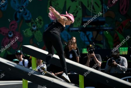 Stock Image of Leticia Bufoni, of Brazil, grinds down a rail during the Dew Tour skateboard women's street semifinals in Long Beach, Calif