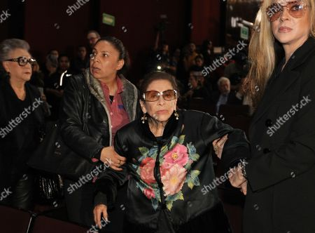 Stock Image of Ofelia (C), mother of Mexican actress and dancer Edith Gonzalez as her daughter's coffin is placed in the theater Jorge Negrete of Mexico City, Mexico, 14 June 2019. Relatives, friends, colleagues and admirers said goodbye to the actress Edith Gonzalez, who died due to a cancer on 13 June 2019.