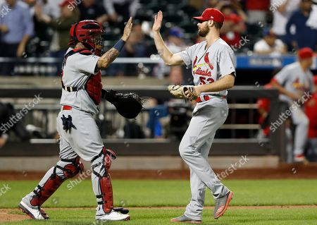 Yadier Molina, John Grant. St. Louis Cardinals' catcher Yadier Molina, left, congratulates relief pitcher John Gant (53) after the Cardinals defeated the New York Mets 9-5 in a baseball game, in New York