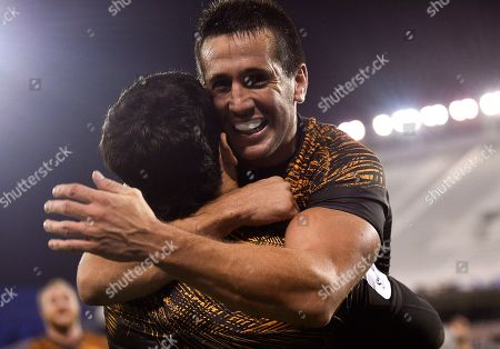 Matias Moroni of Argentina's Jaguares, top, celebrates with the teammate Santiago Gonzalez Iglesias, after scoring against Japan's Sunwolves during a Super Rugby match in Buenos Aires, Argentina