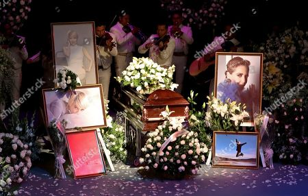 Mariachi musicians perform behind the coffin of Mexican actress Edith Gonzalez on stage of the the Jorge Negrete Theatre during a wake one day after her passing in Mexico City, . The soap opera actress died from ovarian cancer at age 54