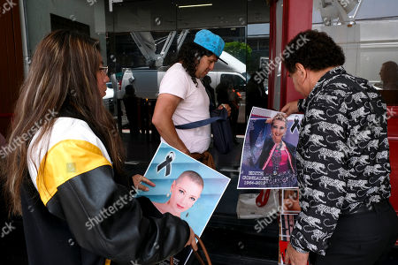 People buy posters of Mexican actress Edith Gonzalez outside Jorge Negrete Theatre, where her wake is taking place, in Mexico City, . The soap opera actress died from ovarian cancer at age 54