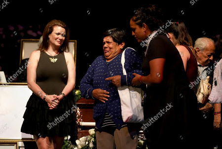A woman gets emotional during the wake of Mexican actress Edith González at the Jorge Negrete Theatre in Mexico City, . The soap opera actress died from ovarian cancer at age 54