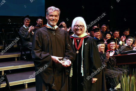 Stock Picture of Pierce Brosnan and Teri Schwartz - Dean of the UCLA School of Theater, Film and Television
