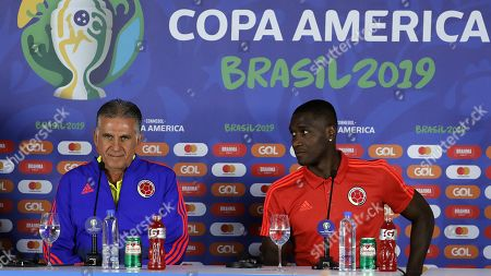 Colombia's national soccer team head coach Portuguese Carlos Queiroz (L) speaks during a press conference accompanied by Colombian player Cristian Zapata at Arena Fonte Nova stadium in Salvador, Brazil, 14 June 2019.