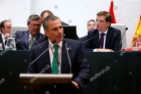 General Secretary of Vox party Javier Ortega Smith (front) gives a speech next to new Madrid Mayor Jose Luis Martinez Almeida (R) during the plenary session of the Town Hall's constitution in Madrid, Spain, 15 June 2019. Town Halls around the country are celebrating plenary sessions in order to constitute their new city governments after the 26 May elections.