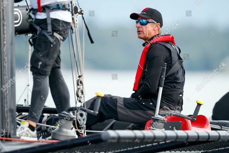 Stock Image of Swiss skipper Ernesto Bertarelli on his M1 class D35 sailboat 'Alinghi 1' at the start of the 81st 'Bol d'Or' sailing race on Lake Geneva in Geneva, Switzerland, 15 June 2019. This weekend's Bol d'Or is the largest sailing race held on a lake in Europe with 465 boats participating.