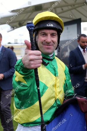 Stock Image of Jockey Robert Winston gives the thumbs up after winning The Pavers Foundation Catherine Memorial Sprint over 6f (£100,000) on RECON MISSION during the MacMillan Charity Raceday held at York Racecourse, York