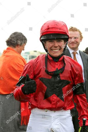 INSTANT ATTRACTION (1) ridden by Charlotte Atkinson and trained by Jedd O'Keeffe wins The Ernest Cooper Macmillan Ride Of Their Lives Charity Race over 1m 1f and the jockey gives the thumbs upduring the MacMillan Charity Raceday held at York Racecourse, York