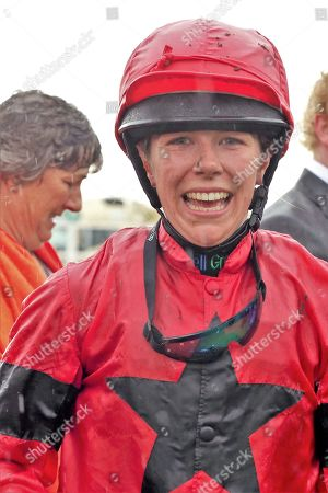 INSTANT ATTRACTION (1) ridden by Charlotte Atkinson and trained by Jedd O'Keeffe wins The Ernest Cooper Macmillan Ride Of Their Lives Charity Race over 1m 1f and the jockey gives the thumbs up during the MacMillan Charity Raceday held at York Racecourse, York