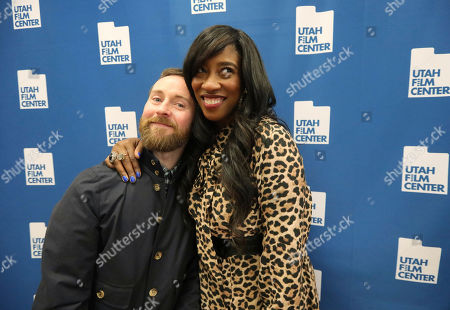 """Aaron Ruell, Shondrella Avery. Aaron Ruell, who played the character Kip, and Shondrella Avery, who played LaFawnduh, hug during a photo-op as they celebrate the 15th anniversary of """"Napoleon Dynamite,"""" in Salt Lake City"""