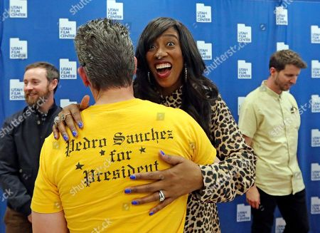 """Shondrella Avery, who played the character LaFawnduh, hugs a fan wearing a Pedro shirt during a photo-op as they celebrate the 15th anniversary of """"Napoleon Dynamite,"""" in Salt Lake City"""