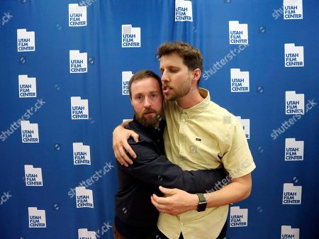 """Aaron Ruell, Jon Heder. Aaron Ruell, who played the character Kip, left, and Jon Heder, who played Napoleon Dynamite, hug during a photo-op as they celebrate the 15th anniversary of the cult classic comedy """"Napoleon Dynamite,"""" in Salt Lake City"""