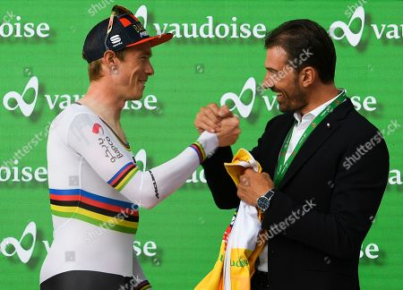 The new overall leader Rohan Dennis from Australia of Bahrain-Merida Pro Cycling Team, left, reacts in the yellow leader jersey next to former Swiss racer Fabian Cancellara, after the prologue, a 9.5 km race against the clock, with start and finish in Langnau im Emmental, Switzerland, at the 83st Tour de Suisse UCI ProTour cycling race, 15 June 2019.