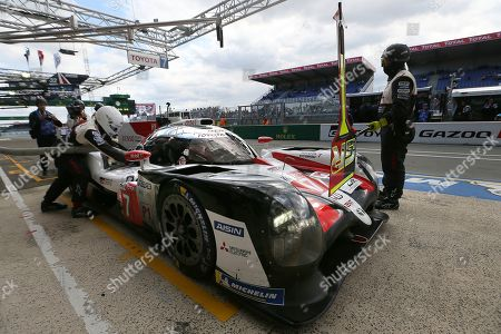 The Toyota TS050 Hybrid No7 of the Toyota Gazoo Racing Team driven by Mike Conway of Britain, Kamui Kobayashi of Japan and Jose Maria Lopez of Argentina refuels in its stand during a stop during the 87th 24-hour Le Mans endurance race, in Le Mans, western France