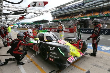 The Toyota TS050 Hybrid No8 of the Toyota Gazoo Racing Team driven by Mike Conway of Britain, Kamui Kobayashi of Japan and Jose Maria Lopez of Argentina refuels in its stand during a stop during the 87th 24-hour Le Mans endurance race, in Le Mans, western France