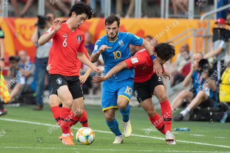 Stock Photo of Serhii Buletsa (C) of Ukraine and Kim Jung-min (L) and Hwang Tae-hyeon (R) of South Korea in action during the FIFA U-20 World Cup 2019 final soccer match between Ukraine and South Korea in Lodz, Poland, 15 June 2019.