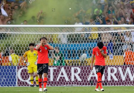 South Korea goalkeeper Lee Gwang-yeon, Lee Ji-sol and Kim Hyun-woo, from left to right, react after Ukraine scored their third goal during the final match between Ukraine and South Korea at the U20 World Cup soccer in Lodz, Poland
