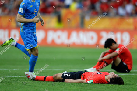 South Korea's Oh Se-hun, foreground, reacts to the final whistle at the end of the final match between Ukraine and South Korea at the U20 World Cup soccer in Lodz, Poland,. Ukraine won 3-1