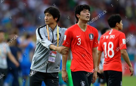South Korea coach Chung Jung-yong comforts South Korea's Lee Jae-ik at the end of the final match between Ukraine and South Korea at the U20 World Cup soccer in Lodz, Poland,. Ukraine won 3-1