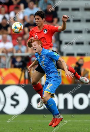 South Korea's Oh Se-hun, top, vies for the ball with Ukraine's Yukhym Konoplia during the final match between Ukraine and South Korea at the U20 World Cup soccer in Lodz, Poland