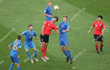 South Korea's Oh Se-hun, (9), jumps for the ball with Ukraine's Danylo Beskorovainyi (13) during the final match between Ukraine and South Korea at the U20 World Cup soccer in Lodz, Poland