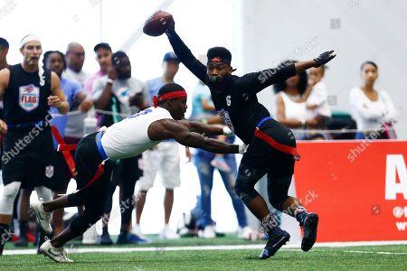 Darryl Jones, Corey Webb. Strong Island Bulldogs' Darryl Jones defends TMT's Corey Webb during the American Flag Football League Tournament in Florham Park, N.J
