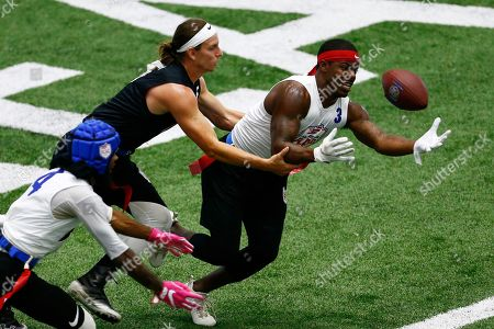 Greg Meek, Darryl Jones. TMT's Greg Meek has the ball stripped by Strong Island Bulldogs' Darryl Jones during the American Flag Football League Tournament in Florham Park, N.J