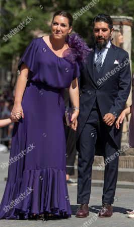 Stock Image of Singer Nina Pastori and her husband Chaboli arrive for the Real Madrid soccer player Sergio Ramos and Pilar Rubio wedding ceremony at the Sevilla's cathedral, southern Spain, 15 June 2019.