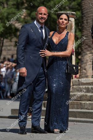 Stock Picture of Soccer player Pepe Reina and his wife Yolanda Ruiz arrive for the Real Madrid soccer player Sergio Ramos and Pilar Rubio wedding ceremony at the Sevilla's cathedral, southern Spain, 15 June 2019.