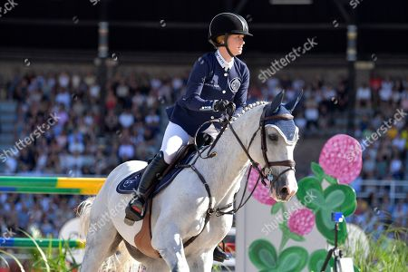 Jennifer Gates of USA rides the horse Pumped Up Kicks during the second round of the team jumping event of Sweden Global Champions League at Stockholm Olympic Stadium, in Stockholm, Sweden, 15 June 2019.