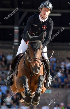 Scott Brash of Great Britain rides the horse Hello Mr President during the second round of the team jumping event of Sweden Global Champions League at Stockholm Olympic Stadium, in Stockholm, Sweden, 15 June 2019.