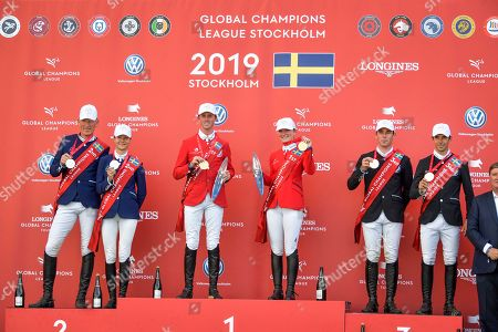 (L-R) Second placed Ludger Beerbaum and Malin Baryard-Johnsson, winners Ben Maher and Emily Moffitt and third placed Mark McAuley and Eduardo Alvarez Aznar pose on the podium after the second round of the team jumping event of Sweden Global Champions League at Stockholm Olympic Stadium, in Stockholm, Sweden, 15 June 2019.