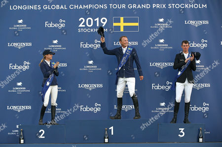 Stock Image of (L-R) Second placed Malin Baryard-Johnsson of Sweden, winner Peder Fredricson of Sweden and third placed Jos Verlooy of Belgium celebrate on the podium after the International jumping competition Global Champions Tour Grand Prix of Stockholm at Stockholm Olympic Stadium, in Stockholm, Sweden, 15 June 2019.