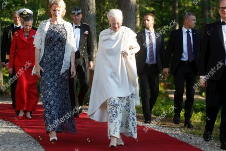 Stock Photo of Queen Margrethe II of Denmark (C) arrives for a gala dinner at the Arvo Part Center in Laulasmaa, Estonia, 15 June 2019. Queen Margrethe II of Denmark visits Tallinn from 15 to 16 June to take part in celebrations of the 800th anniversary of the Danish flag, the 135th anniversary of the Estonian flag, Estonia's centennial as well as Estonian-Danish relations.