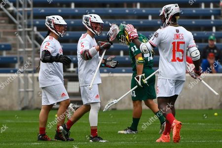 Chaos' Connor Fields (5), Miles Thompson (2) and Myles Jones (15) celebrate a goal as Redwoods' Eddy Glazener looks on during a Premier Lacrosse League game on in Bridgeview, Ill