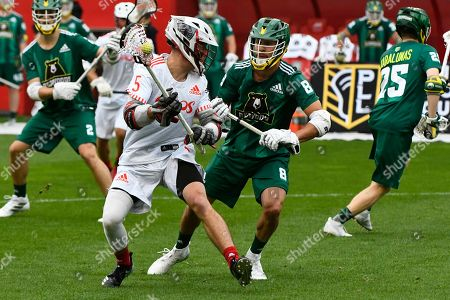 Chaos' Connor Fields battles Redwoods' Brent Adams during a Premier Lacrosse League game on in Bridgeview, Ill