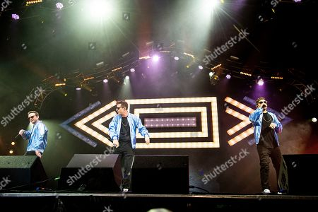 Stock Image of Akiva Schaffer, Andy Samberg, Jorma Taccone. Akiva Schaffer, from left, Andy Samberg, and Jorma Taccone of The Lonely Island perform at the Bonnaroo Music and Arts Festival, in Manchester, Tenn