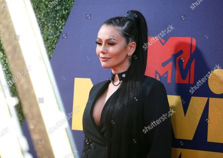 "Jenni ""JWOWW"" Farley arrives at the MTV Movie and TV Awards, at the Barker Hangar in Santa Monica, Calif"