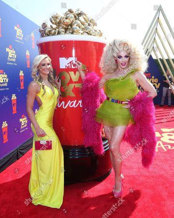 Molly McKinnon, Alyssa Edwards. Molly McKinnon, left, and Alyssa Edwards arrive at the MTV Movie and TV Awards, at the Barker Hangar in Santa Monica, Calif