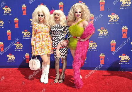 Trixie Mattel, Katya, Alyssa Edwards. Trixie Mattel, from left, Katya and Alyssa Edwards arrive at the MTV Movie and TV Awards, at the Barker Hangar in Santa Monica, Calif