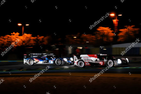 Toyota Gazoo Racing (starting no.7) in a Toyota TS050 Hybrid with Mike Conway of Great Britain, Kamui Kobayashi of Japan and Jose Maria Lopez of Argentina in front of Signatech Alpine Matmut (starting no.36) in a Alpine A470 Gibson with Nicolas Lapierre of France, Andre Negrao of Brasil and Pierre Thiriet of France in action at night during the Le Mans 24 Hours race in Le Mans, France, 15 June 2019. The race is scheduled to finish at 3pm local time on 16 June.