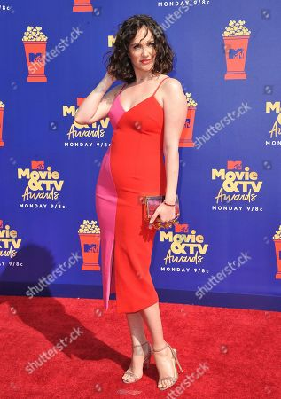 Kate Siegel arrives at the MTV Movie and TV Awards, at the Barker Hangar in Santa Monica, Calif