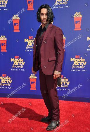 Justin Brescia arrives at the MTV Movie and TV Awards, at the Barker Hangar in Santa Monica, Calif