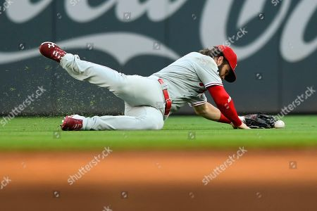 Philadelphia Phillies right fielder Bryce Harper lets a fly ball off the bat of Atlanta Braves' Josh Donaldson come out of his glove allowing a single during the first inning of a baseball game, in Atlanta