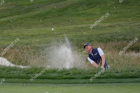 Roberto Castro hits out of a bunker on the 17th hole during the third round of the U.S. Open Championship golf tournament, in Pebble Beach, Calif