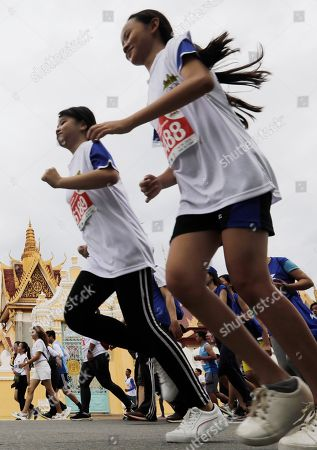 Cambodian people participate in a fun run in front of the Royal Palace in Phnom Penh, Cambodia, 16 June 2019. The Cambodian National Olympic Committee organized the Phnom Penh International Half Marathon to celebrate Queen Mother Norodom Monineath's birthday.