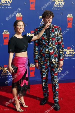Haley Lu Richardson and Brett Dier arrive for the 2019 MTV Movie & TV Awards at the Barker Hangar, Santa Monica, California, USA, 15 June 2019. The movies are nominated by producers and executives from MTV and the winners are chosen online by the general public.